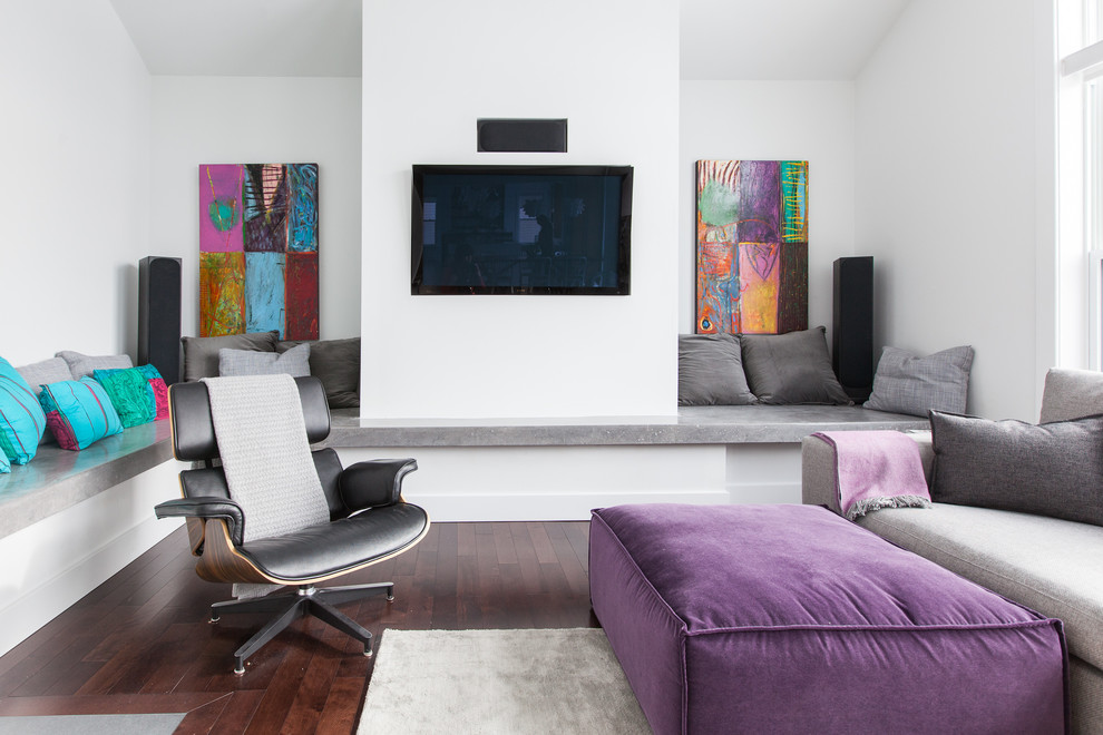 Trendy living room photo in Other with white walls and a wall-mounted tv