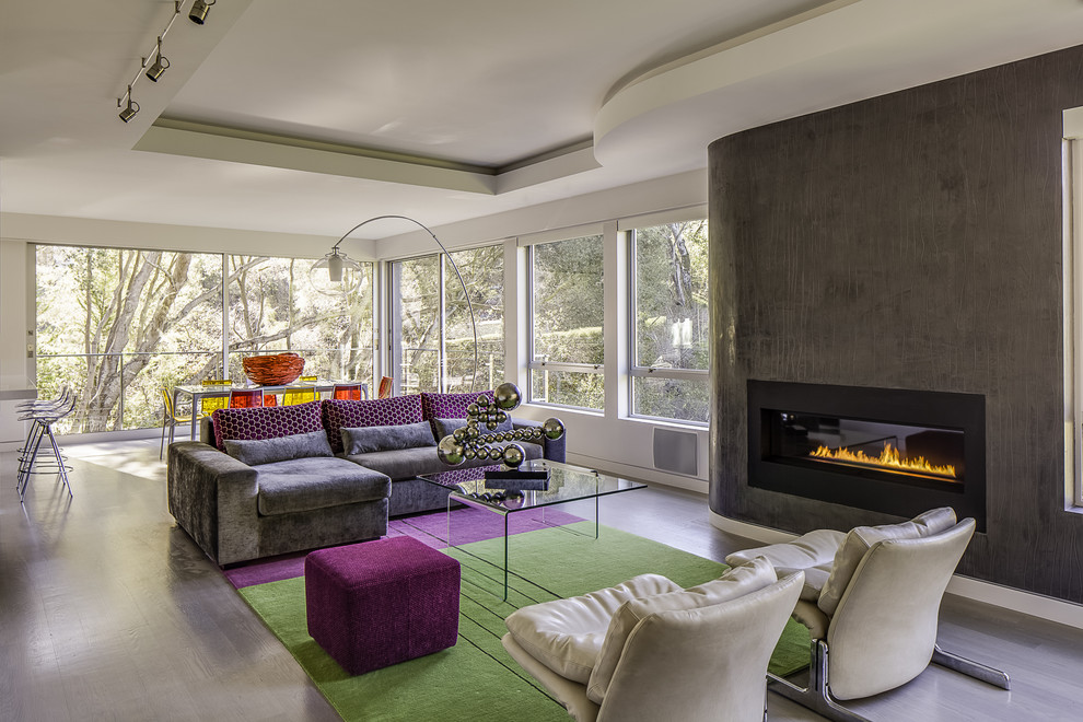 Inspiration for a contemporary open concept gray floor living room remodel in San Francisco with a ribbon fireplace