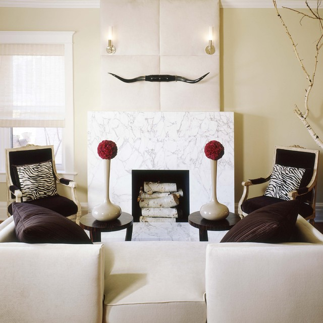 Horns Placed Over The White Marble Fireplace Add