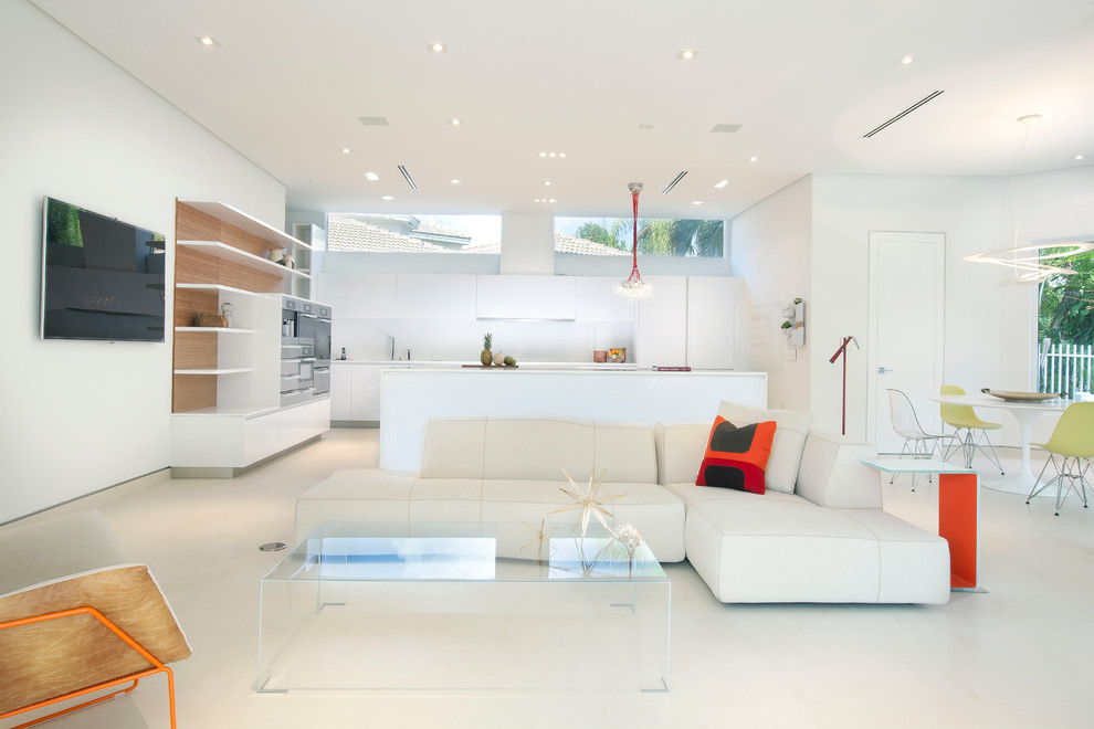 Minimalist open concept white floor living room photo in Miami with white walls and a wall-mounted tv