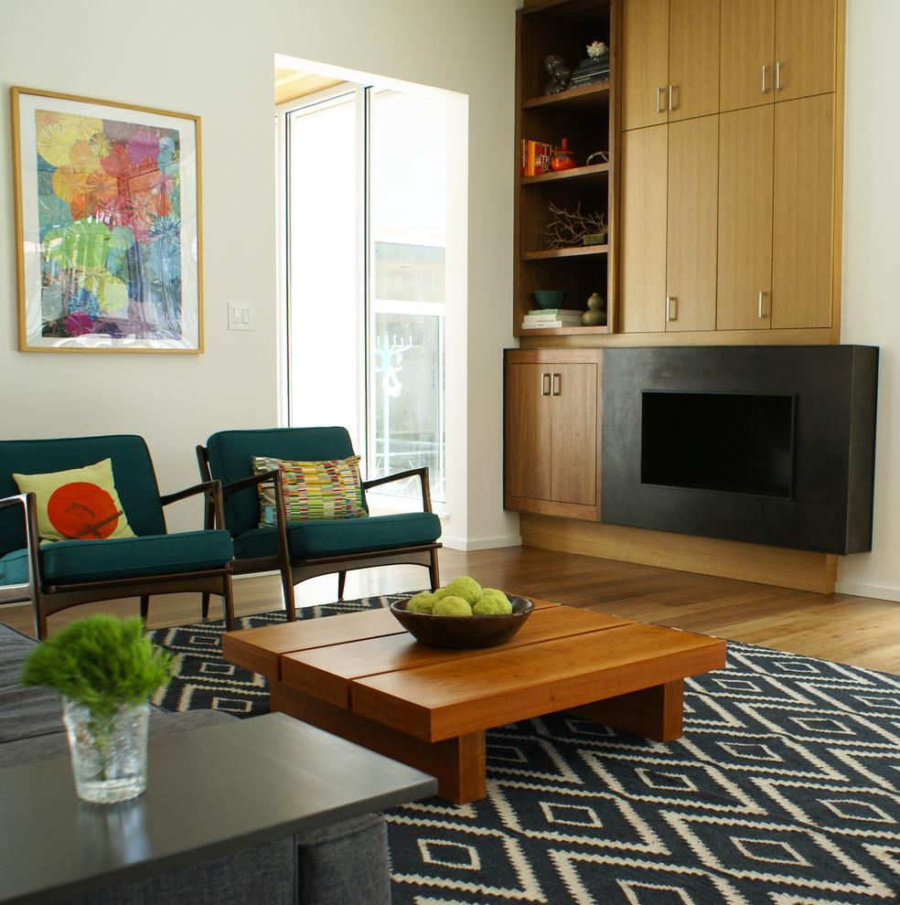 Minimalist medium tone wood floor living room photo in Austin with white walls
