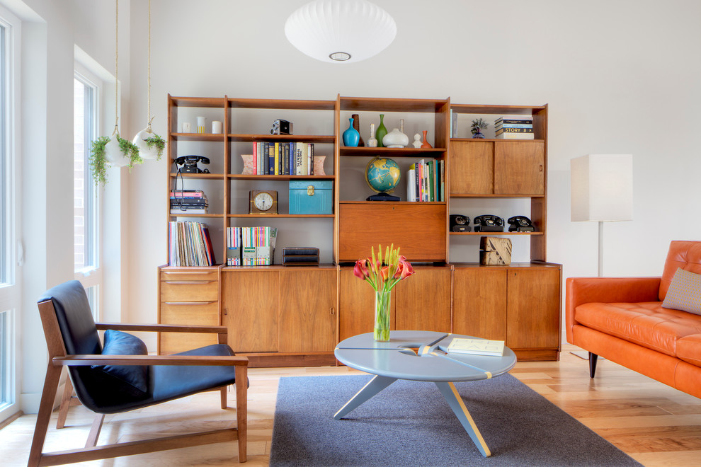 Danish light wood floor living room photo in Chicago with white walls