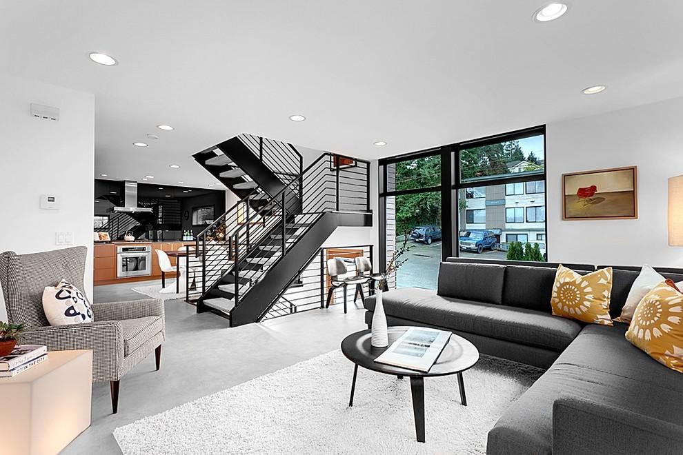 Example of a minimalist concrete floor living room design in Seattle