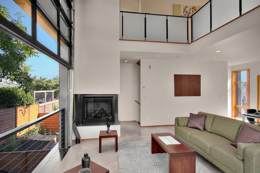 Living room - contemporary living room idea in Seattle with a corner fireplace
