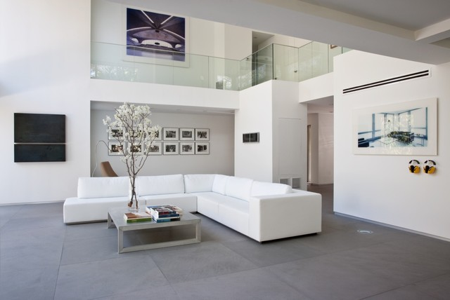 living room tile. Example of a minimalist formal limestone floor and gray living room  design in Kansas City Floor Tiles Modern Living Room Houzz
