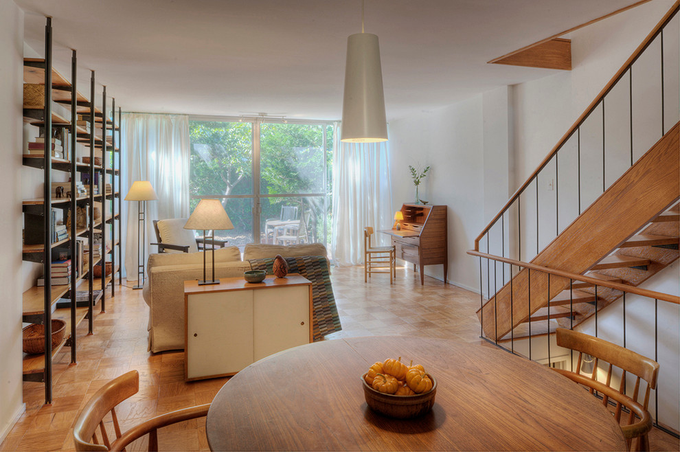 Inspiration for a modern medium tone wood floor living room remodel in DC Metro with white walls