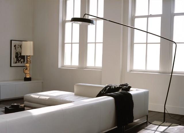 Example of a minimalist black floor living room design in Philadelphia with white walls