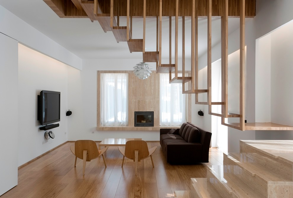 Example of a minimalist living room design in Montreal with white walls