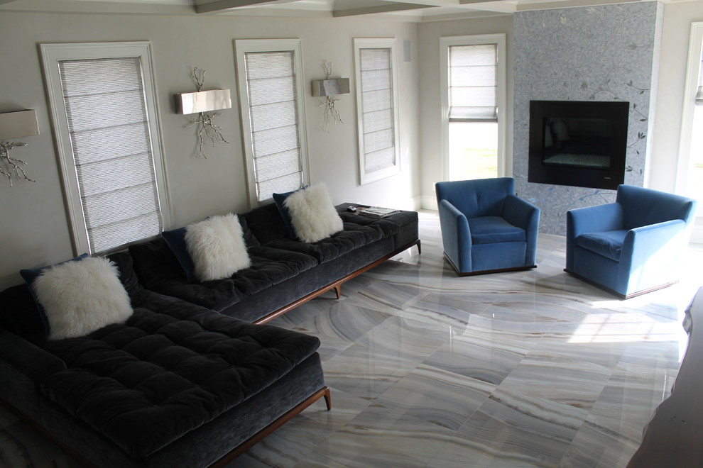 Example of a mid-sized minimalist formal and enclosed marble floor living room design in New York with white walls and a wall-mounted tv