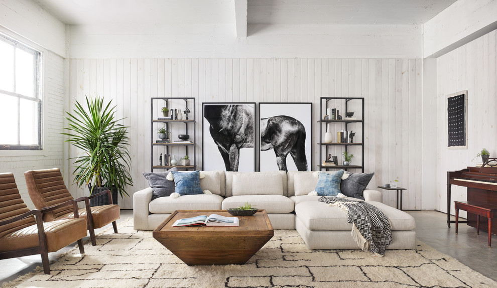 Example of a transitional concrete floor and gray floor living room design in New York with a music area and white walls