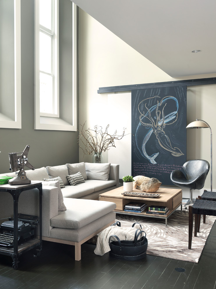 Trendy living room photo in Boston with a concealed tv