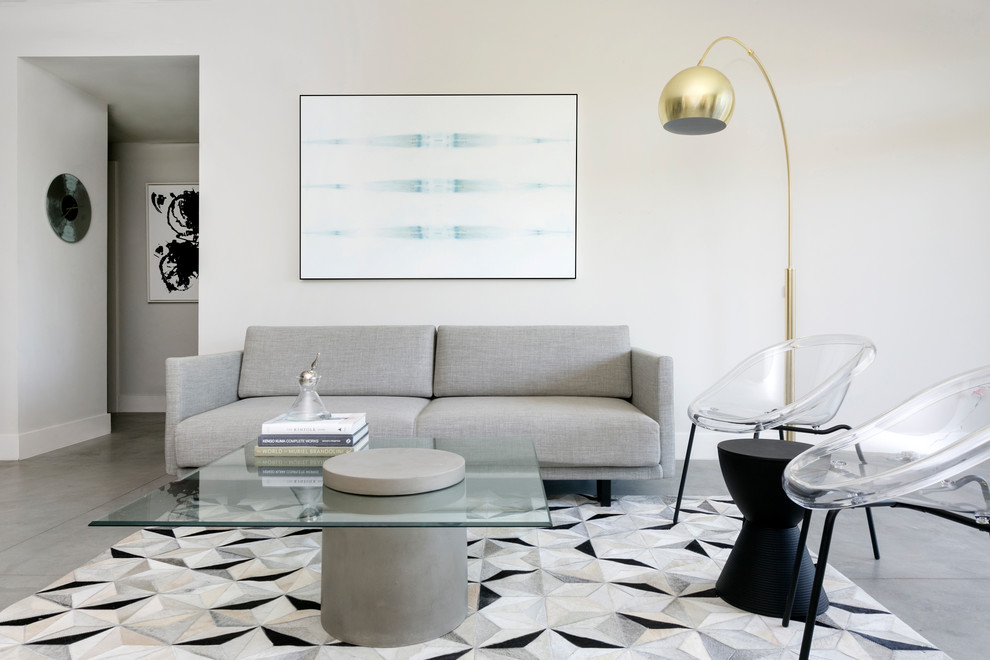 Small minimalist loft-style concrete floor and gray floor living room photo in Los Angeles with gray walls, no fireplace and a wall-mounted tv