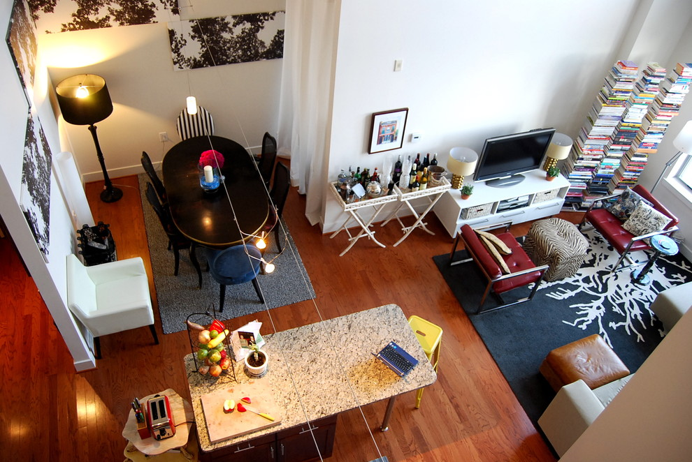 Living room library - eclectic living room library idea in DC Metro with a tv stand