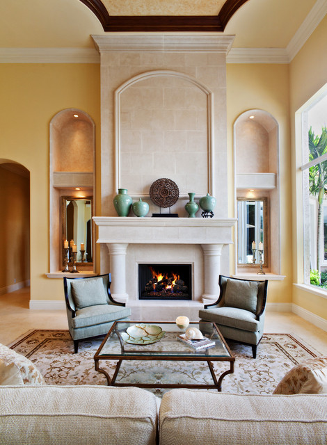 Inspiration for a mediterranean living room remodel in Miami with yellow walls