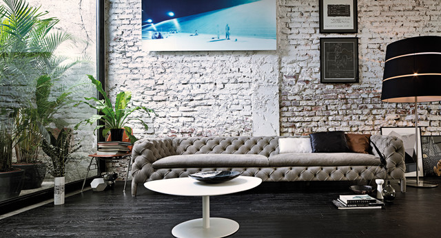 Modern Minimalist Painted Brick Wall With Button Back Sofa And Lacquered Coffee Contemporary Living