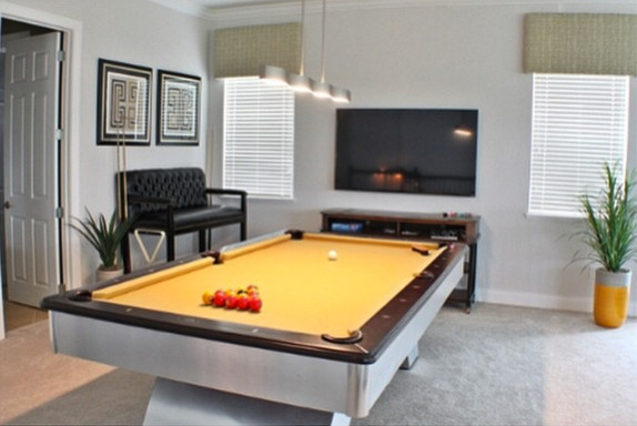 modern pool table in loft modern living room orlando