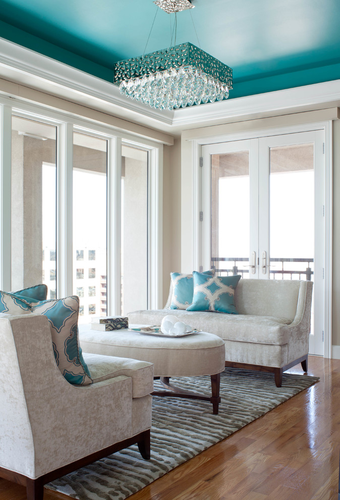 Example of a trendy formal medium tone wood floor living room design in Denver with white walls