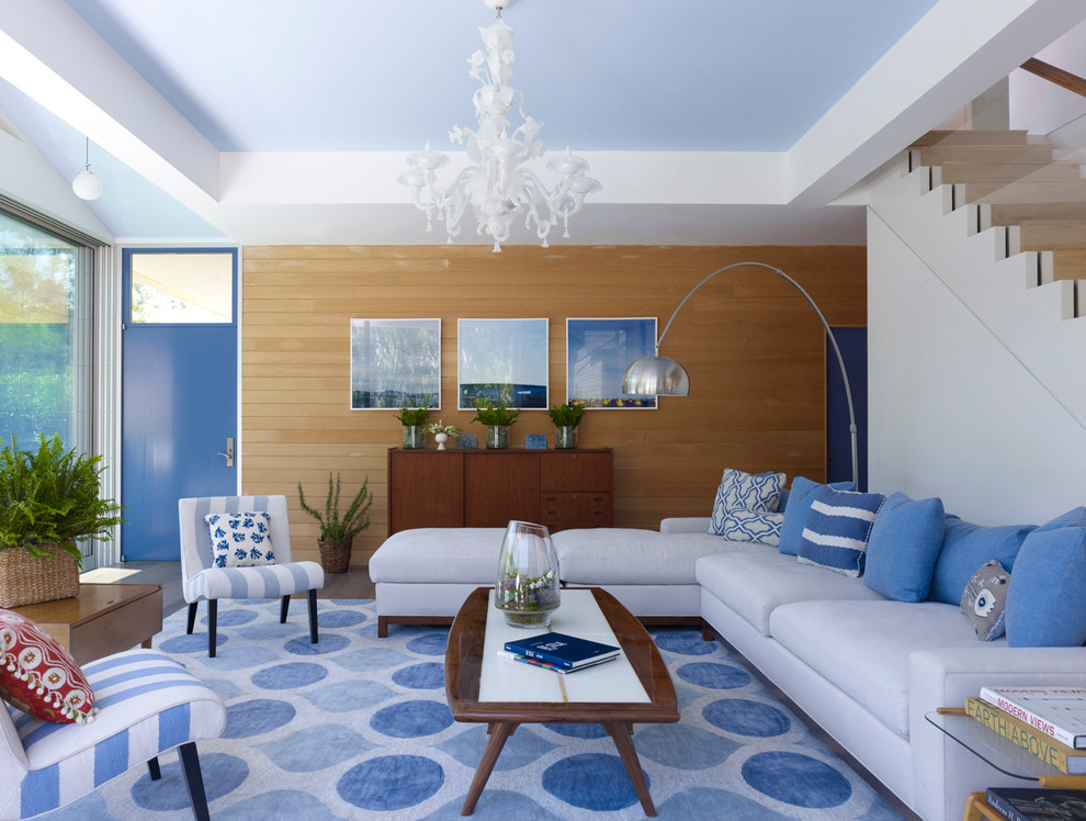 Example of a trendy living room design in New York with no tv