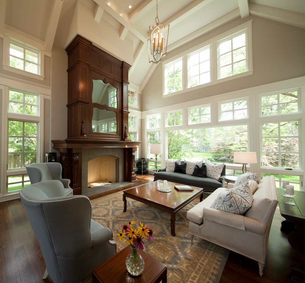 Example of a transitional living room design in Minneapolis with beige walls, a standard fireplace and no tv