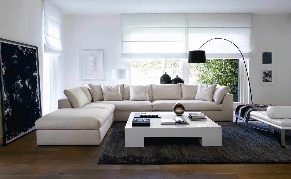 Example of a large minimalist living room design in Philadelphia with white walls