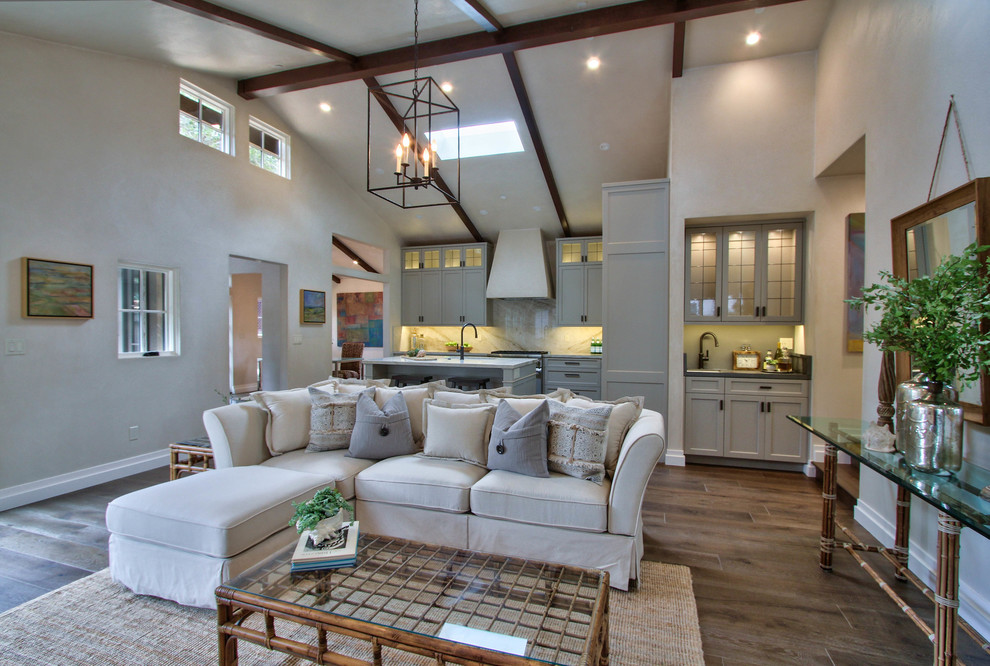Example of a large transitional formal and open concept dark wood floor and brown floor living room design in Other with white walls, no fireplace and no tv