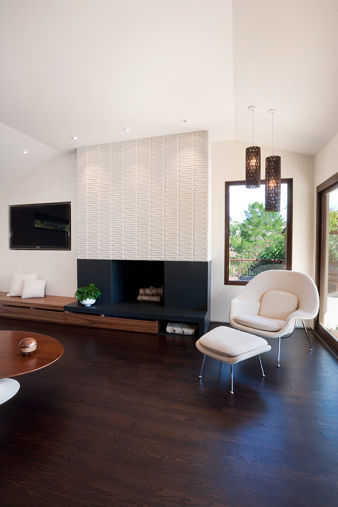 Mid-century modern open concept dark wood floor and brown floor living room photo in San Francisco with a tile fireplace, beige walls and a standard fireplace