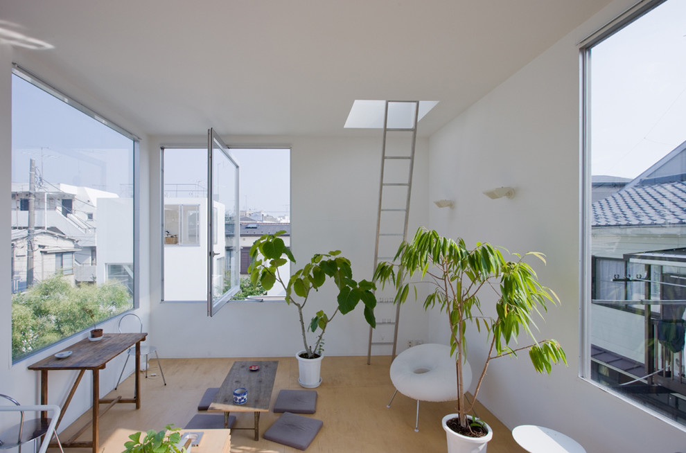 Living room - small contemporary living room idea in Other with white walls