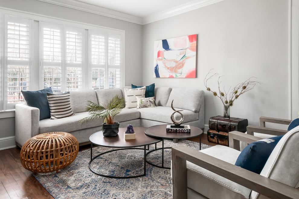 Living room - mid-sized scandinavian open concept medium tone wood floor and brown floor living room idea in Atlanta with gray walls