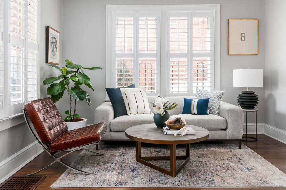 Inspiration for a mid-sized scandinavian open concept dark wood floor and brown floor living room remodel in Atlanta with no fireplace and gray walls