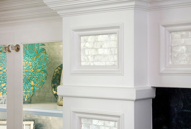 Real mother of pearl adorns the recessed panels of this custom fire place surround.  To add to the sense of depth and interest in the room
