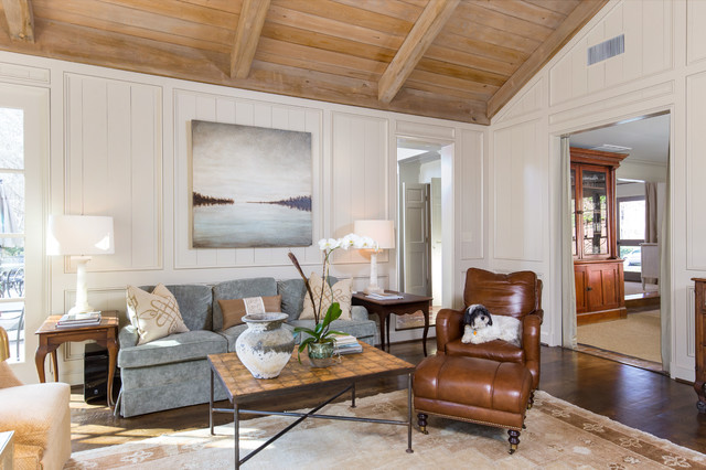 Family room - traditional enclosed medium tone wood floor family room idea in Birmingham with white walls