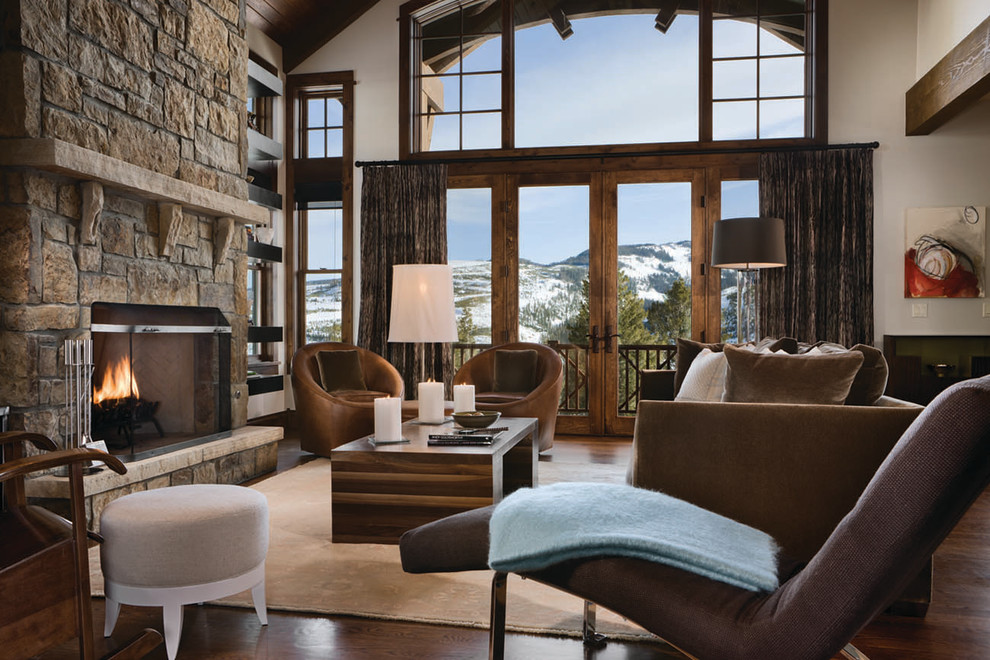 Example of a mid-sized mountain style living room design in Other with a stone fireplace