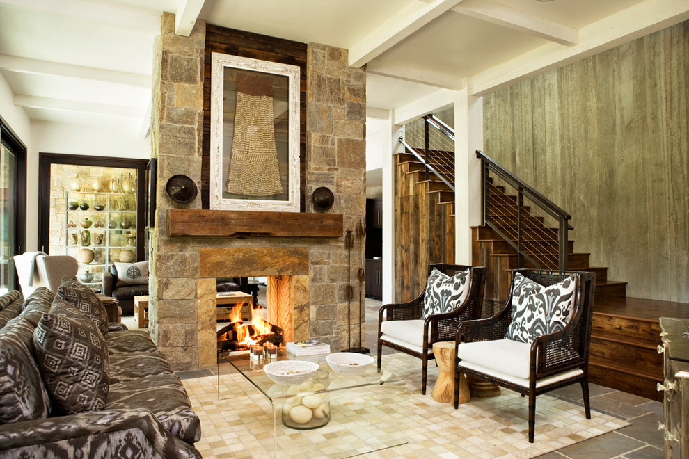 Mountain style formal and open concept living room photo in Other with a two-sided fireplace and a stone fireplace