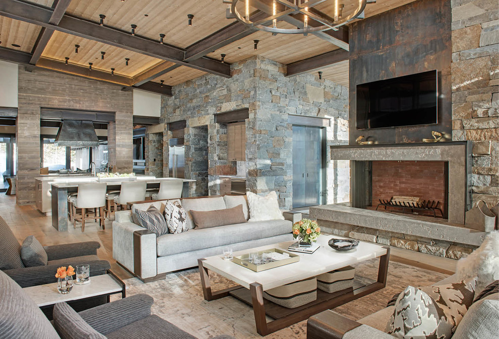 Inspiration for a large modern open concept medium tone wood floor and brown floor living room remodel in Other with a stone fireplace, a wall-mounted tv and a corner fireplace
