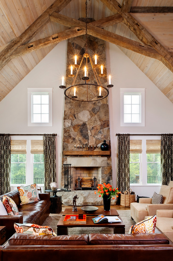 Living room - large rustic medium tone wood floor living room idea in Richmond with beige walls, a standard fireplace and a stone fireplace