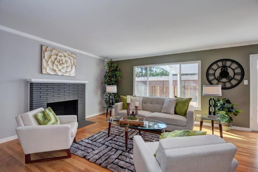 Mid-sized 1960s formal and open concept light wood floor and beige floor living room photo in San Francisco with gray walls, a standard fireplace, a tile fireplace and no tv