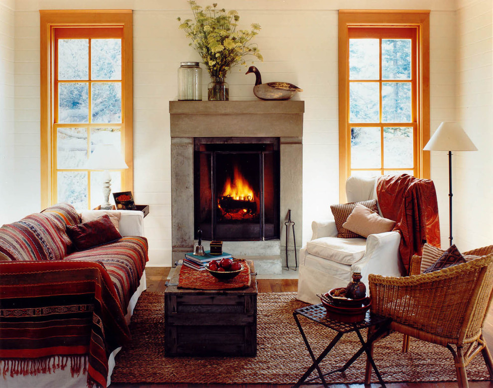 Mid-sized mountain style living room photo in Seattle with a standard fireplace and beige walls