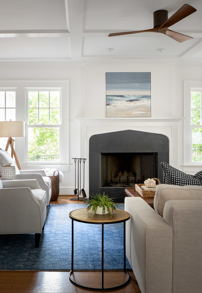 Living room - large coastal open concept light wood floor living room idea in Atlanta with white walls, a standard fireplace and a stone fireplace