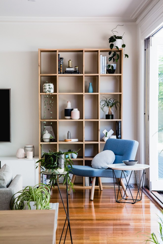 Living room - scandinavian light wood floor living room idea in Melbourne with white walls and a wall-mounted tv