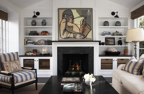 How does the painting hide the tv does the artwork slide for Hide tv in living room