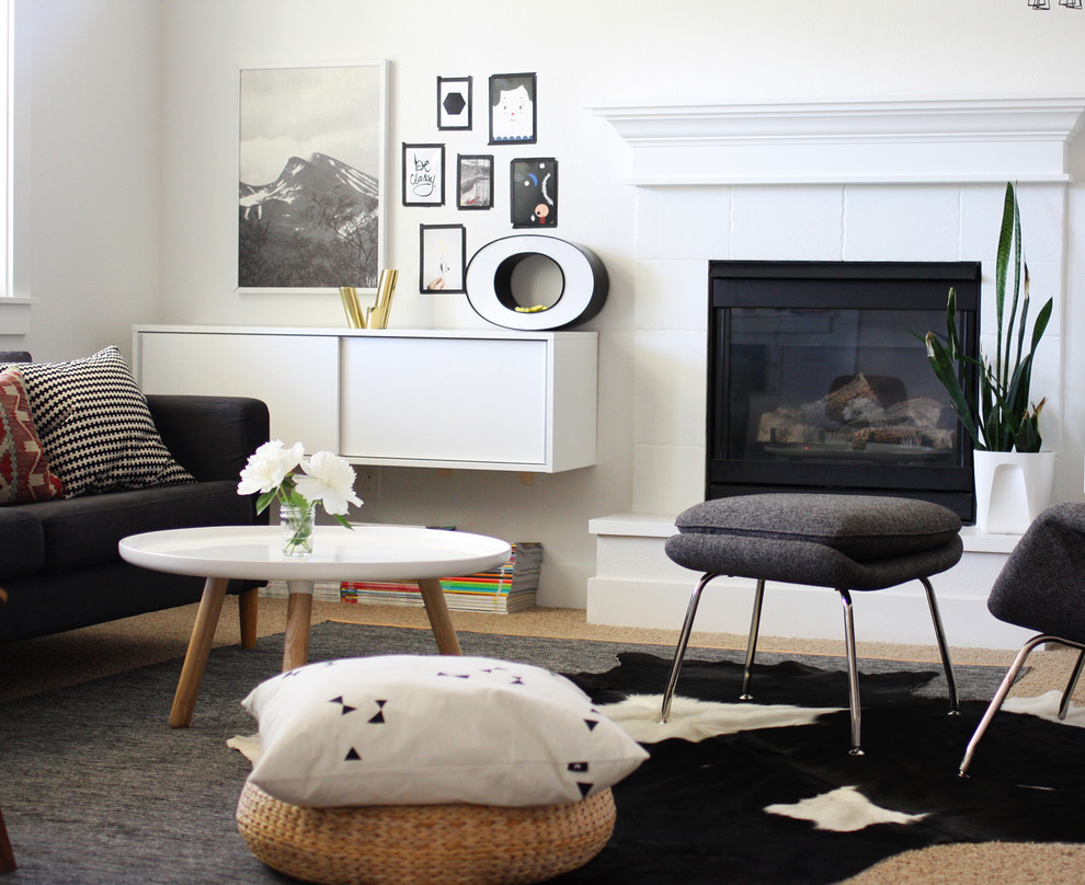 Living room - scandinavian living room idea in Boise with white walls and a standard fireplace