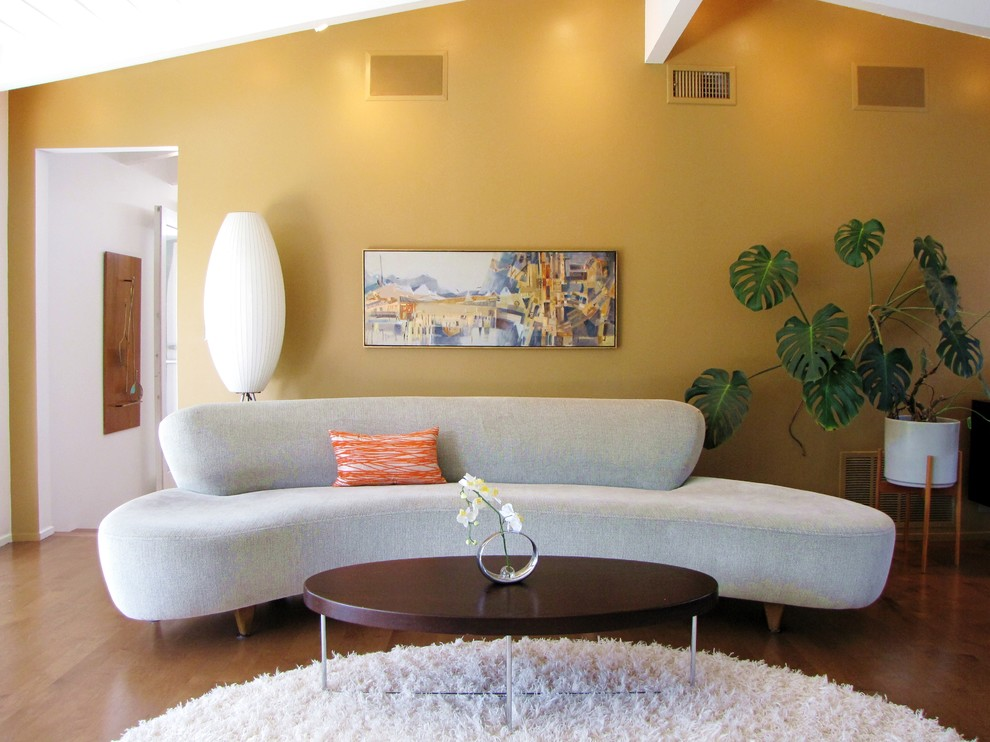 Inspiration for a midcentury modern living room remodel in Orange County with yellow walls