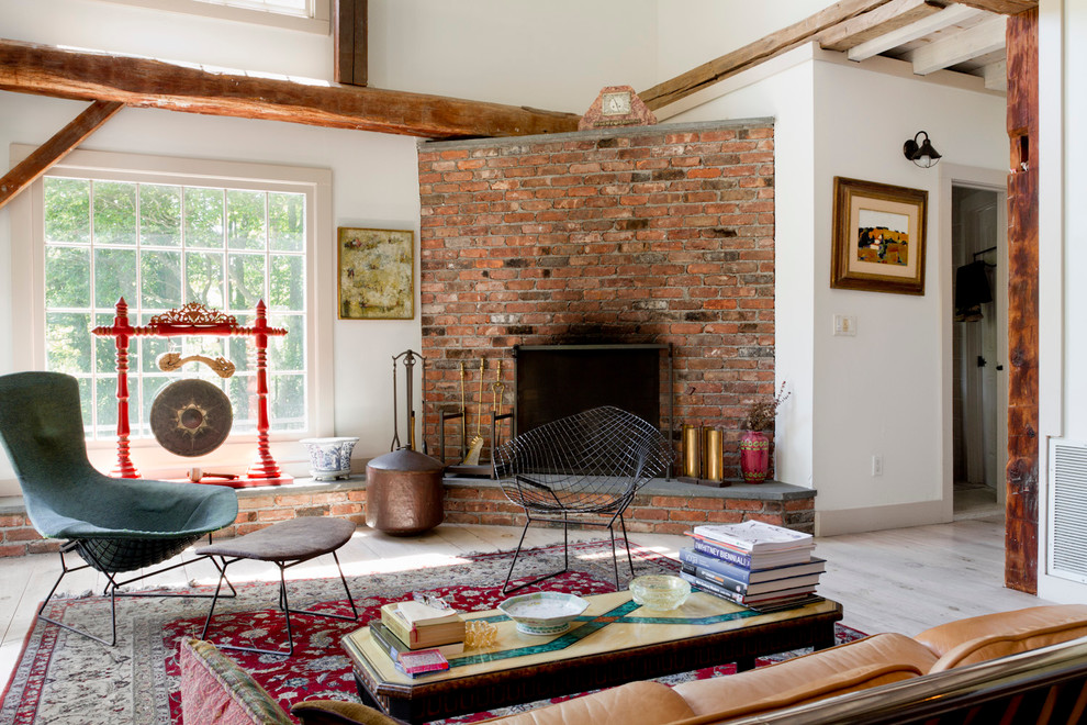 Inspiration for an eclectic open concept living room remodel in New York with white walls, a corner fireplace and a brick fireplace