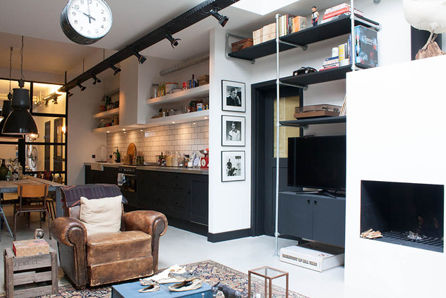 My Houzz: A Garage transformed into a boy's dream pad eclectic-living-room