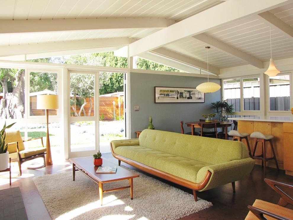 Mid-century modern cork floor living room photo in Orange County