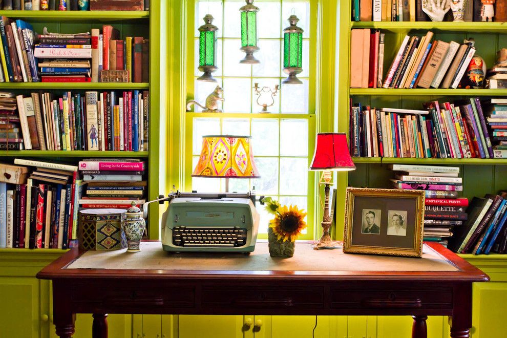 Living room library - cottage living room library idea in New York with green walls