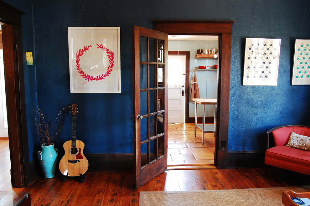 Living room - farmhouse enclosed living room idea in New York with blue walls