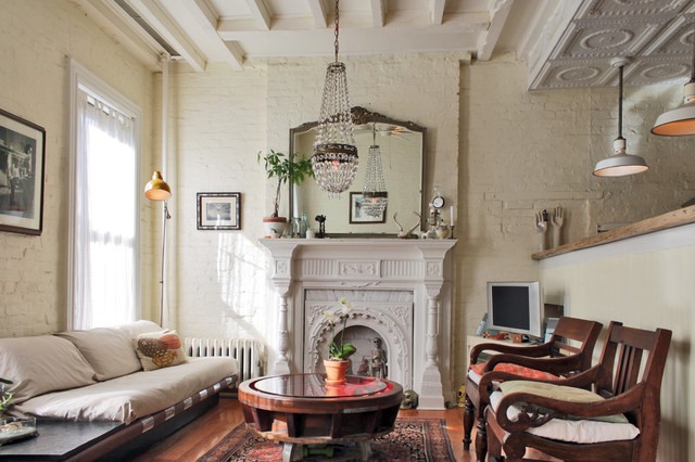 My houzz antiques and curio items add interest to a for Brownstone living room decorating ideas
