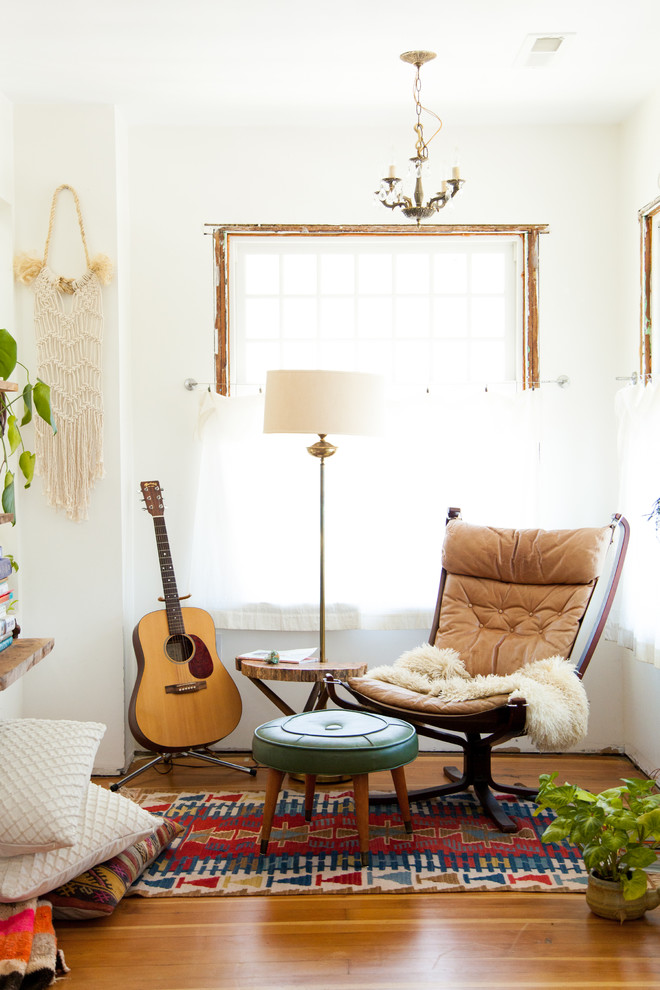 Inspiration for a large eclectic medium tone wood floor living room remodel in Portland with white walls, no fireplace and a music area