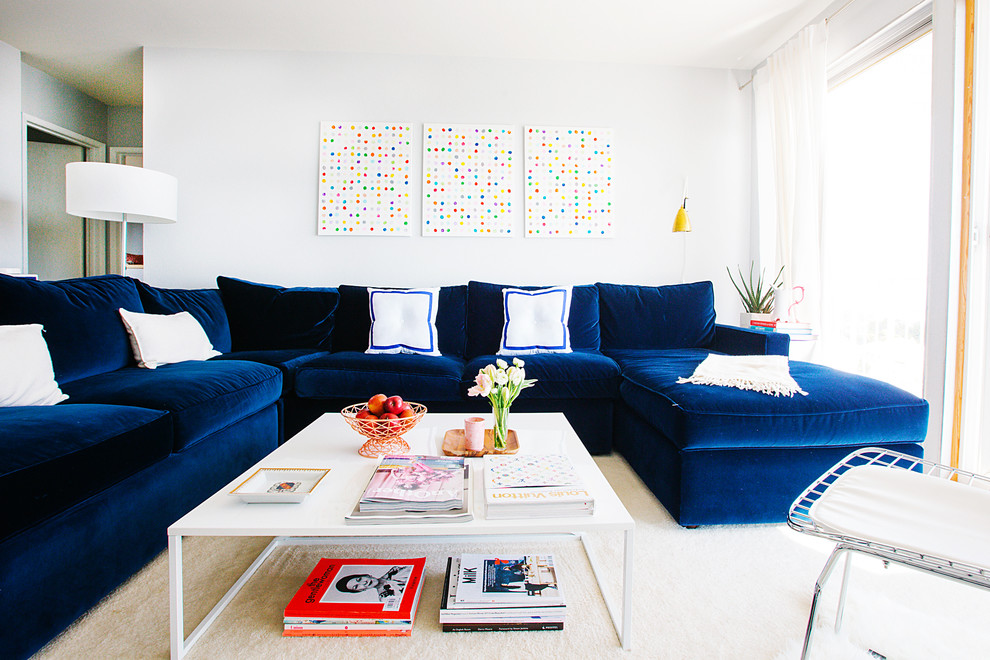 Example of a transitional living room design in San Francisco with white walls